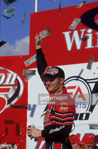 Driver Dale Earnhardt Jr celebrates the win after the EA Sports 500 at the Talladega Superspeedway in Talladaga Alabama