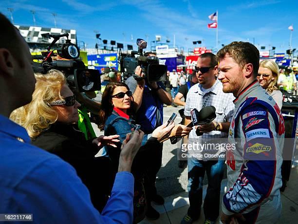 NASCAR driver Dale Earnhardt Jr is interviewed after running practice laps on Wednesday Febraury 20 at Daytona International Speedway in Daytona...