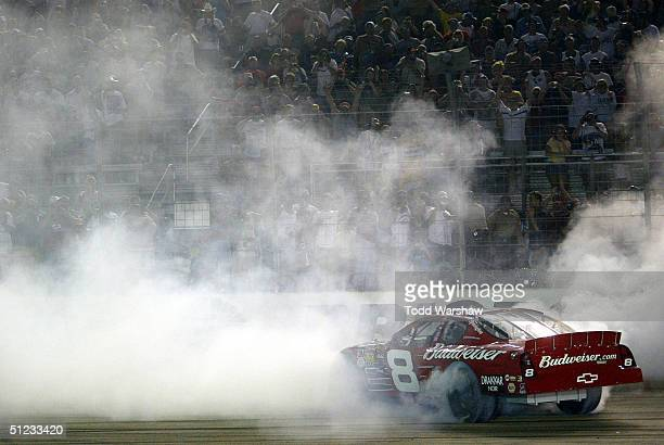 Driver Dale Earnhardt Jr of the Earnhardt Racing Chevrolet celebrates after winning the NASCAR Nextel Cup Series Sharpie 500 on August 27 2004 at...
