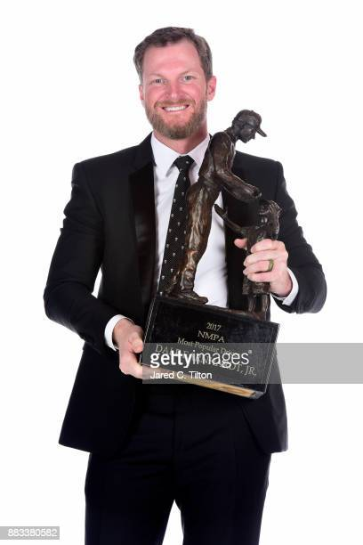 NASCAR driver Dale Earnhardt Jr poses with NASCAR most popular driver award following the Monster Energy NASCAR Cup Series awards at Wynn Las Vegas...