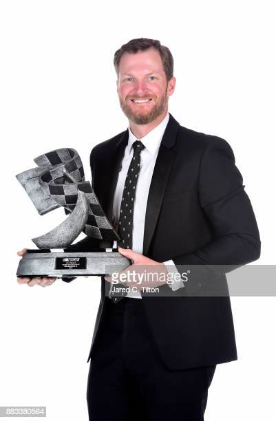 NASCAR driver Dale Earnhardt Jr poses with The Bill France Award of Excellence following the Monster Energy NASCAR Cup Series awards at Wynn Las...