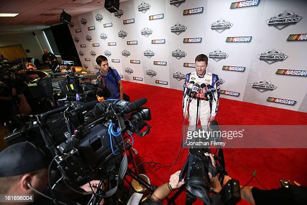 Driver Dale Earnhardt Jr speaks to the media during 2013 NASCAR media day at Daytona International Speedway on February 14 2013 in Daytona Beach...