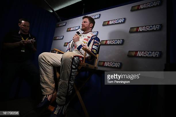 Driver Dale Earnhardt Jr speaks to the media during the 2013 NASCAR media day at Daytona International Speedway on February 14 2013 in Daytona Beach...