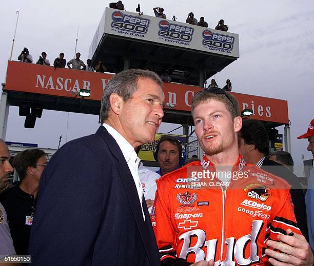 NASCAR driver Dale Earnhardt Jr talks with Texas Governer and US presidential candidate George W Bush before the start of the Pepsi 400 NASCAR race...