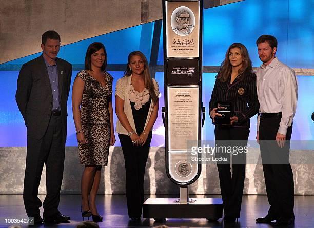 Driver Dale Earnhardt Jr Teresa Earnhardt Kerry Earnhardt Kelley Earnhardt Elledge and Taylor Earnhardt stand on stage as Dale Earnhardt Sr gets...
