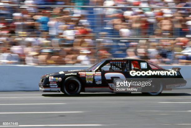 Driver Dale Earnhardt races past the grandstand during the CocaCola 500 race on May 29 1988 at Charlotte Motor Speedway in Concord North Carolina