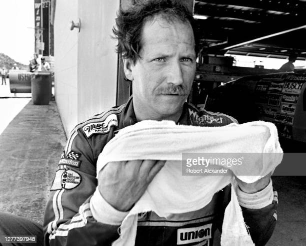 Driver Dale Earnhardt, Sr. Cools off in the speedway garage after competing in the 1983 Firecracker 400 stock car race at Daytona International...