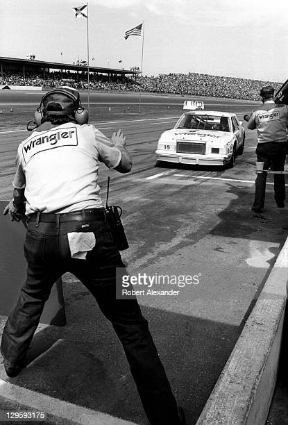 NASCAR driver Dale Earnhardt Sr driving the No 15 Wrangler Cheverolet makes a pit stop during the 1982 Firecracker 400 at the Daytona International...
