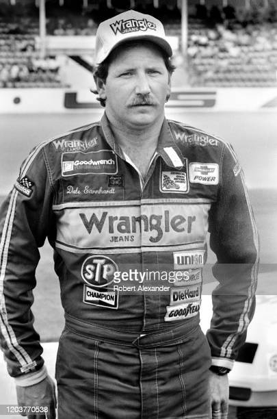 NASCAR driver Dale Earnhardt Sr poses for photographers prior to the start of the 1986 Daytona 500 stock car race at Daytona International Speedway...