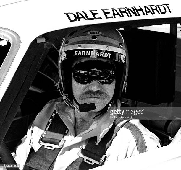 NASCAR driver Dale Earnhardt Sr sits in his car at the Daytona International Speedway prior to the start of the 1980 Daytona 500 on February 17 1980...