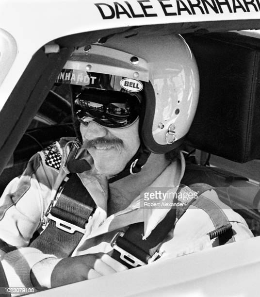 NASCAR driver Dale Earnhardt Sr sits in his racecar prior to the start of the 1980 Daytona 500 stock car race at Daytona International Speedway in...