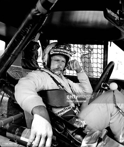 NASCAR driver Dale Earnhardt Sr sits in his racecar prior to the start of the 1981 Firecracker 400 NASCAR race at Daytona International Speedway in...
