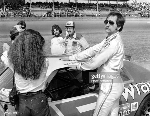 Driver Dale Earnhardt Sr. Stands beside his racecar prior to the start of the 1982 Daytona 500 stock car race at Daytona International Speedway in...