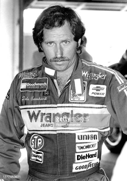 Driver Dale Earnhardt Sr. Stands in the speedway garage prior to the start of the 1983 Daytona 500 stock car race at Daytona International Speedway...