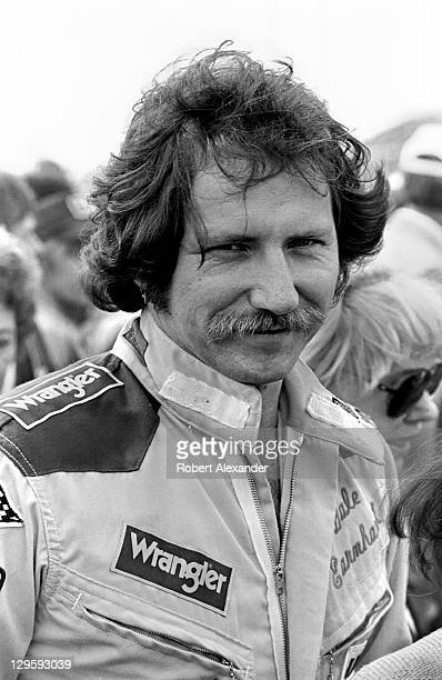 NASCAR driver Dale Earnhardt Sr talks with fans in the infield at the Daytona International Speedway prior to drivers' introductions and the start of...