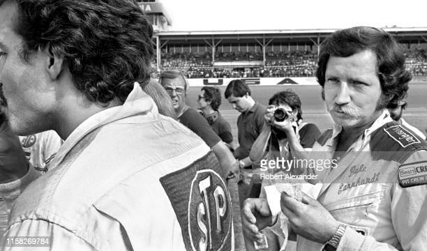 Driver Dale Earnhardt Sr. Waits to be called during driver introductions prior to the start of the 1981 Firecracker 400 NASCAR race at Daytona...