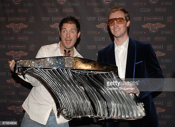 Driver Dan Joyce and Gumball 300 organizer Max Cooper display the remains of Mr Joyce's car after an accident at the Gumball 3000 Playboy Mansion...