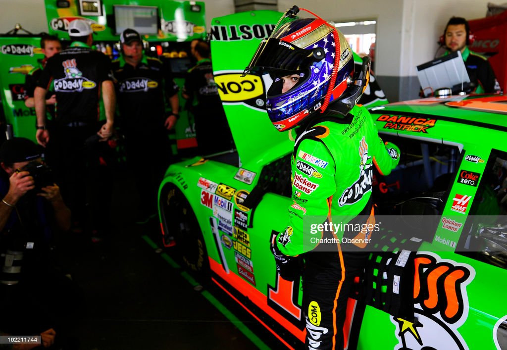 NASCAR driver Danica Patrick climbs out of her car after running practice laps on Wednesday, Febraury 20, 2013, at Daytona International Speedway in Daytona, Florida.