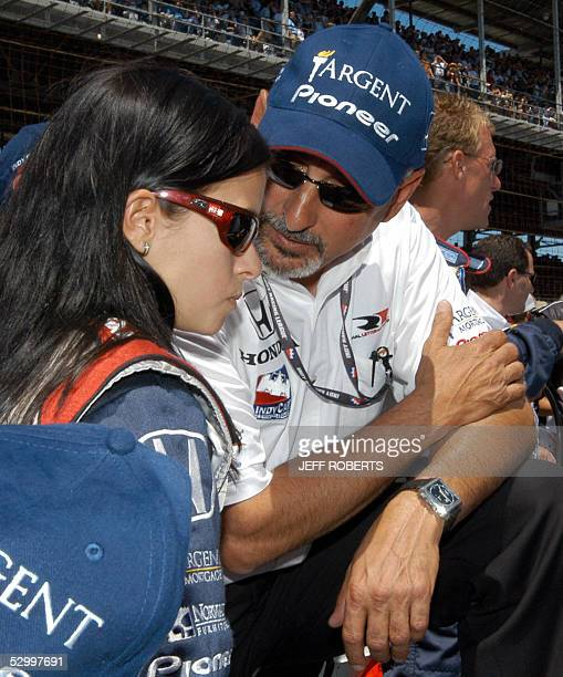 Driver Danica Patrick of the US talks with team owner Bobby Rahal 29 May 2005 before the Indianapolis 500 at the Indianapolis Motor Speedway in...