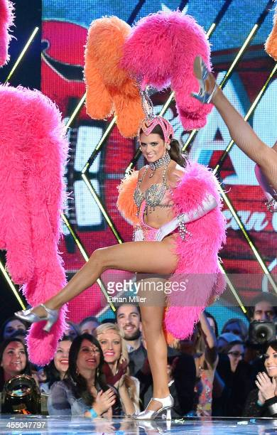 NASCAR driver Danica Patrick performs dressed as a showgirl from the 'Jubilee' show as she cohosts the American Country Awards 2013 at the Mandalay...