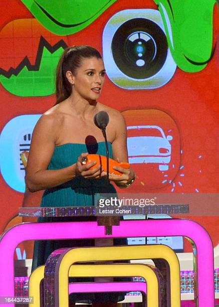 NASCAR driver Danica Patrick performs during Nickelodeon's 26th Annual Kids' Choice Awards at USC Galen Center on March 23 2013 in Los Angeles...