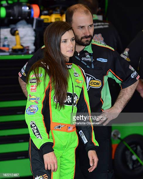 NASCAR driver Danica Patrick watches as crew members make adjustments to her car following practice laps on Wednesday Febraury 20 at Daytona...