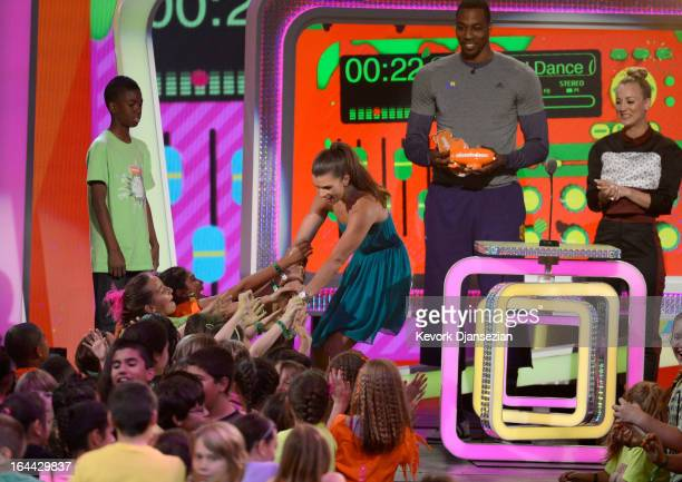 NASCAR driver Danica Patrick winner of Favorite Female Athlete NBA player Dwight Howard and actress Kaley Cuoco speak onstage during Nickelodeon's...