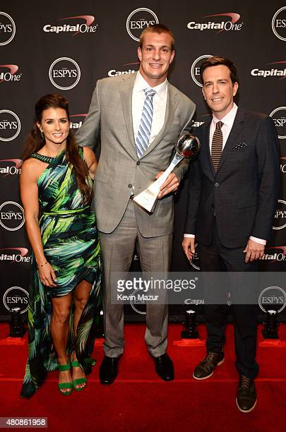 Driver Danica Patrick with NFL player Rob Gronkowski and actor Ed Helms with award for Best Comeback Athlete at The 2015 ESPYS at Microsoft Theater...