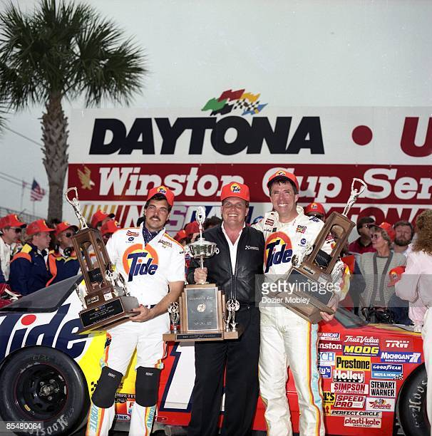 Driver Darrell Waltrip celebrates in Victory lane with crew chief Jeff Hammond and car owner Rick Hendrick after winning the Daytona 500 race on...