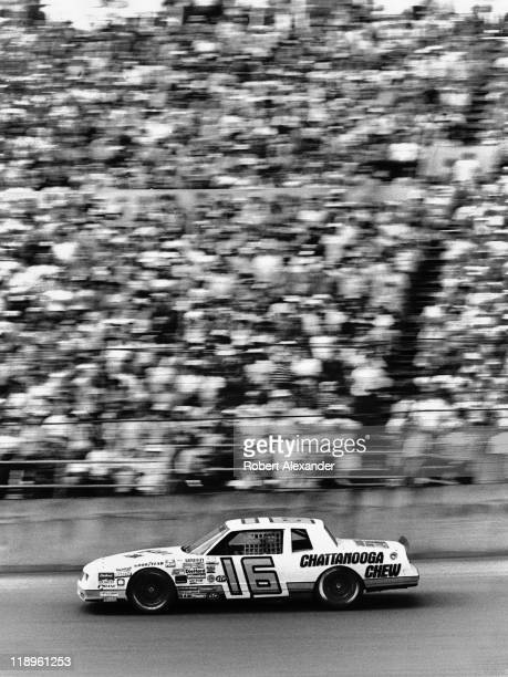 NASCAR driver David Pearson drives past the Daytona International Speedway grandstands during the 1984 Firecracker 400 on July 4 1984 in Daytona...