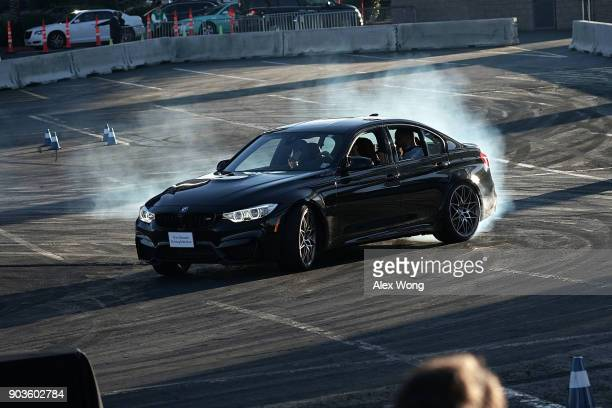 A driver demonstrates drifting with a BMW M5 during CES 2018 at the Las Vegas Convention Center on January 10 2018 in Las Vegas Nevada CES the...