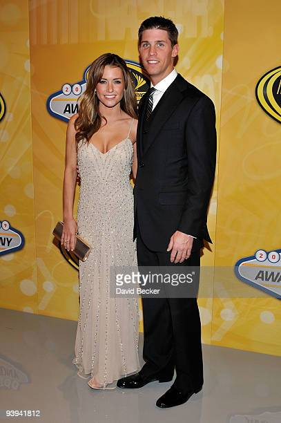 Driver Denny Hamlin and girlfriend Jordan Fish pose on the red carpet for the NASCAR Sprint Cup Series awards banquet during the final day of the...