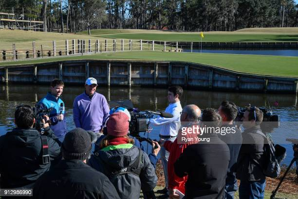 NASCAR driver Denny Hamlin and PGA TOUR golfer Sam Saunders answer questions from the media on the 17th hole at THE PLAYERS Stadium Course at TPC...