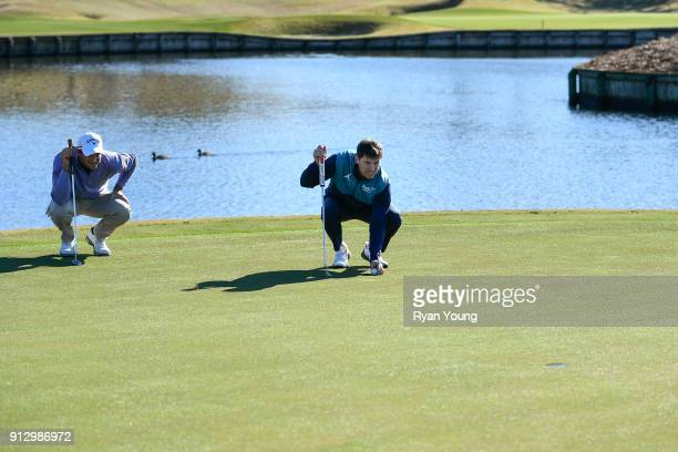 NASCAR driver Denny Hamlin and PGA TOUR golfer Sam Saunders on the 17th hole at THE PLAYERS Stadium Course at TPC Sawgrass on January 31 2018 in...