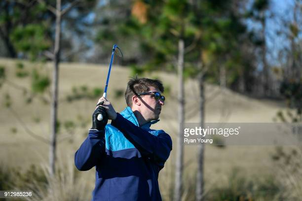 NASCAR driver Denny Hamlin hits balls on the range at TPC Sawgrass on January 31 2018 in Ponte Vedra Beach Florida