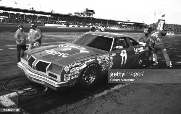 NASCAR driver Donnie Allison driving a race car sponsored by Hawaiian Tropic makes a pit stop during the running of the 1980 Daytona 500 stock car...