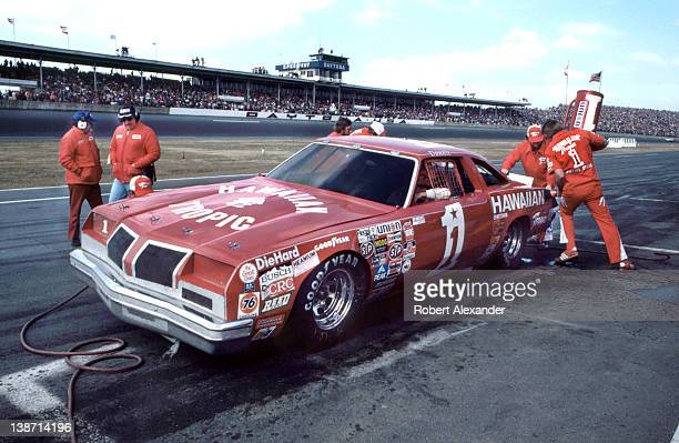 NASCAR driver Donnie Allison driving the No 1 Hawaiian Tropic car makes a pit stop during the 1980 Daytona 500 at the Daytona International Speedway...