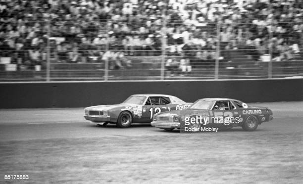 Driver Earl Ross races Bobby Allison during action at the World 600 race on May 26 1964 at the Charlotte Motor Speedway in Concord North Carolina