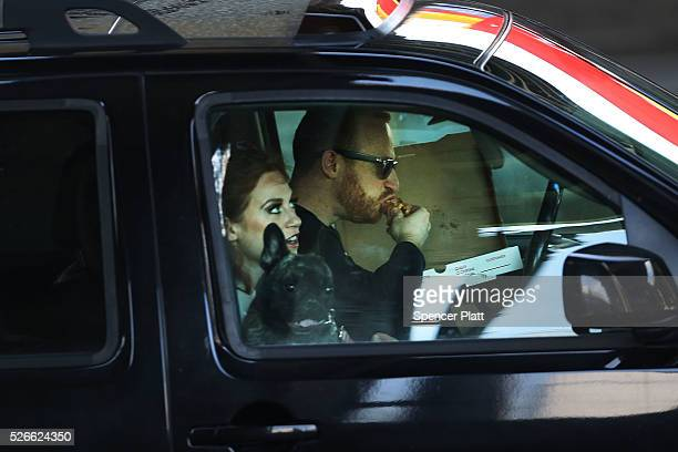 A driver eats while behind the wheel on April 30 2016 in New York City As accidents involving drivers using phones or other personal devices mount...