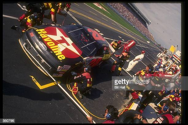 NASCAR driver Ernie Irvan has his car serviced by his pit crew during a NASCAR event Mandatory Credit Bill Hall /Allsport