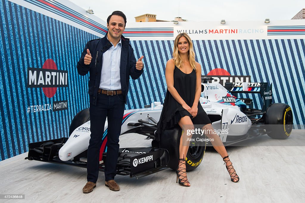 RACING driver Felipe Massa and Bar Refaeli pose with a WILLIAMS MARTINI RACING car at Terrazza MARTINI as she is announced as the global MARTINI Race ambassador. The VIP party kicked off the European Formula One season in MARTINI style at Port Vell, Barcelona on Thursday 7 May 2015. Terrazza MARTINI is open throughout the Spanish Grand Prix weekend.