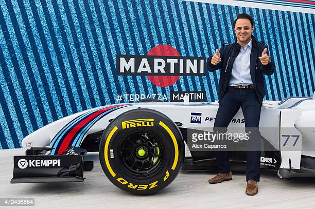 Driver Felipe Massa poses with a WILLIAMS MARTINI RACING car at Terrazza MARTINI to announce Bar Refaeli as the global MARTINI Race ambassador. The...