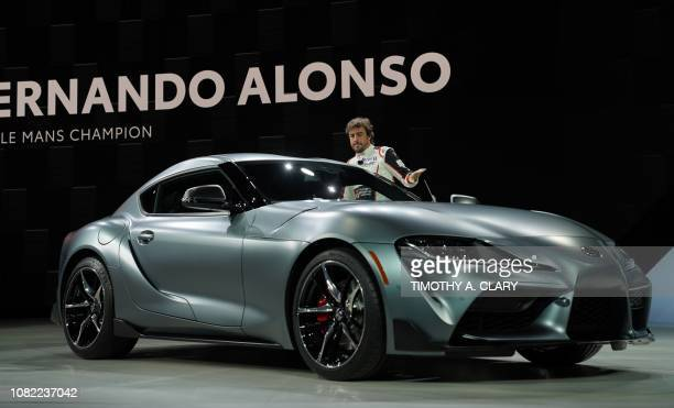 F1 driver Fernando Alonso unveils the Toyota Supra Super GT race car during day one of the 2019 North American International Auto Show January 14...