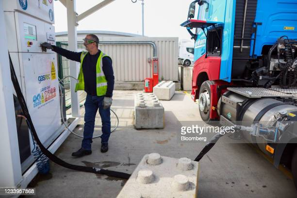 Driver fills a heavy goods vehicle with liquid natural gas at Nicholls Transport premises in Sittingbourne, U.K., on Tuesday, July 13, 2021. Almost a...
