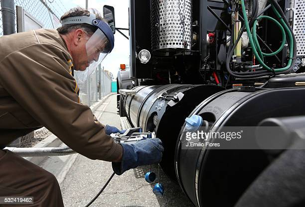 UPS driver fills up a UPS truck with liquid natural gas at the Ontario CA UPS West Coast Hub Thousands of Trucks through out the country are using...