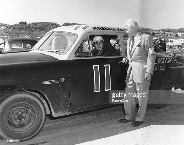 Driver Fireball Roberts poses with NASCAR Secretary and racing historian Bill Tuthill prior to the NASCAR Cup race on the Daytona BeachRoad Course