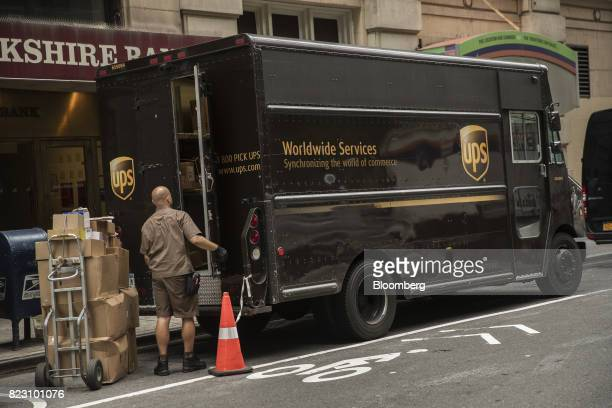 A driver for an independent contractor to United Parcel Service Inc prepares to load packages onto a delivery truck on a street in New York US on...