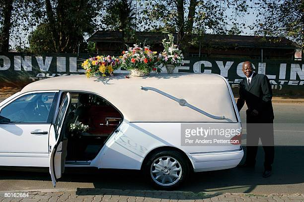 A driver for Kupane undertakers waits to drive a coffin to a funeral at Avalon cemetery on May 4 2007 in Soweto South Africa About 150 funerals are...