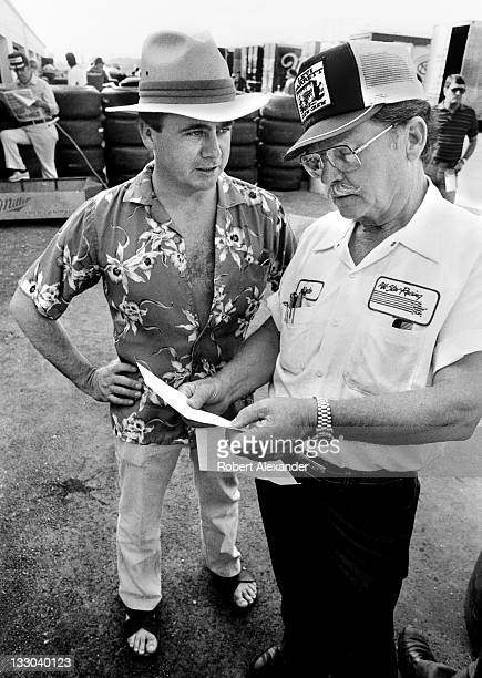 NASCAR driver Geoff Bodine left talks with his crew chief Harry Hyde in the Daytona International Speedway garage area prior to the 1984 Daytona 500...