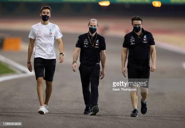 Driver George Russell of Great Britain inspects the track with Mercedes engineers ahead of the F1 Grand Prix of Sakhir at Bahrain International...